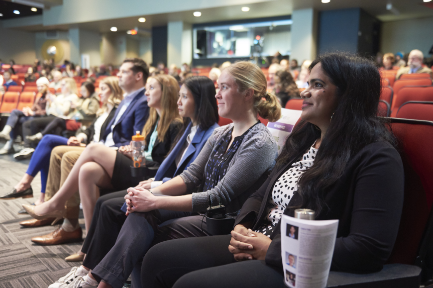 Participants of the 3MT competition sit in a row