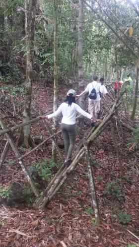 Students cross a traditional bamboo bridge in a Bidayuh community of Sarawak, Malaysia