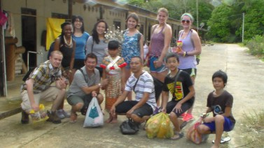 University of Minnesota, Morris, undergraduate Keyah Stone (third from left, back row) and other student researchers interact with community members in Sri Aman, an Iban community in Sarawak, Malaysia