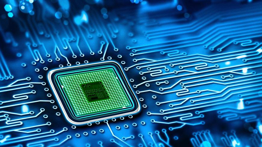 Close up of a green circuit inside a blue microchip