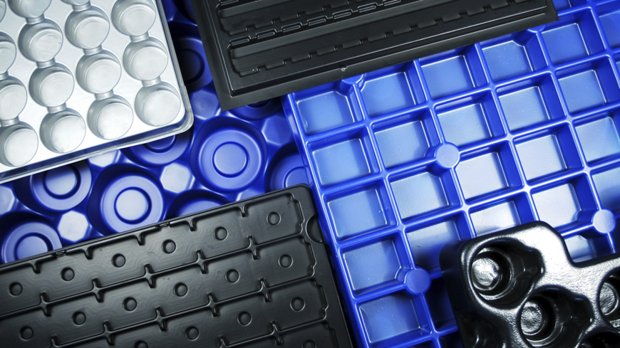 Plastic and metal trays with many compartments
