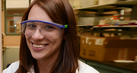 picture of Bridget Ulrich wearing lab safety goggles, in a laboratory workspace