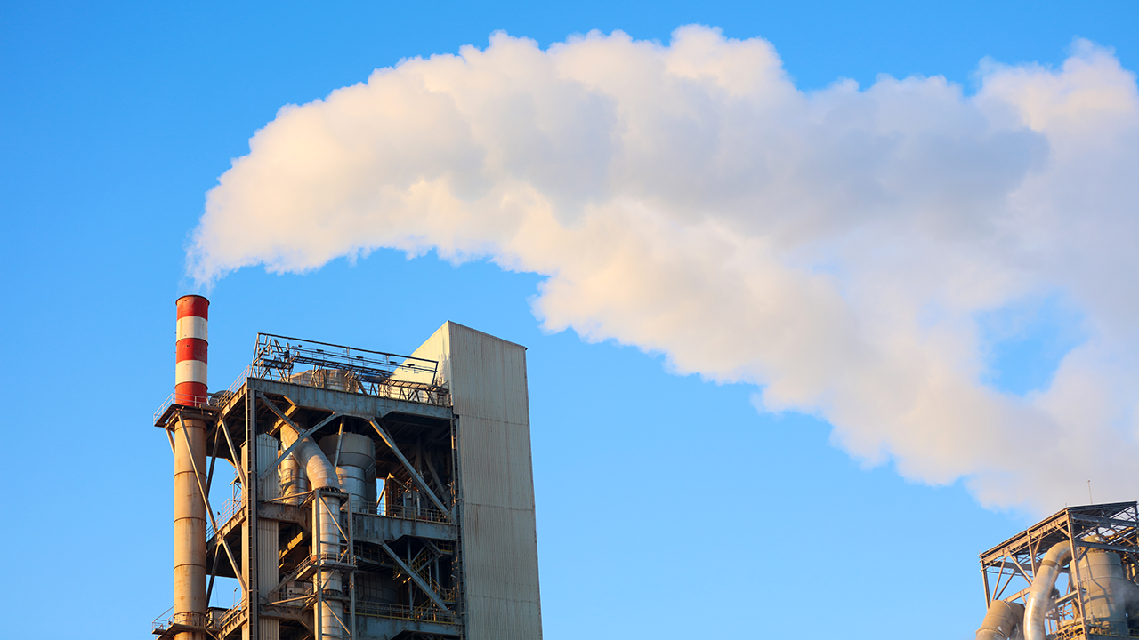 Emissions flow out of a cement plant