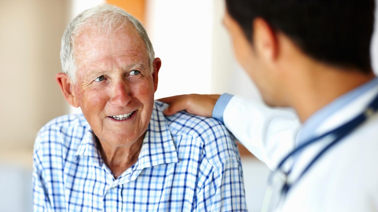 Elderly patient with his doctor