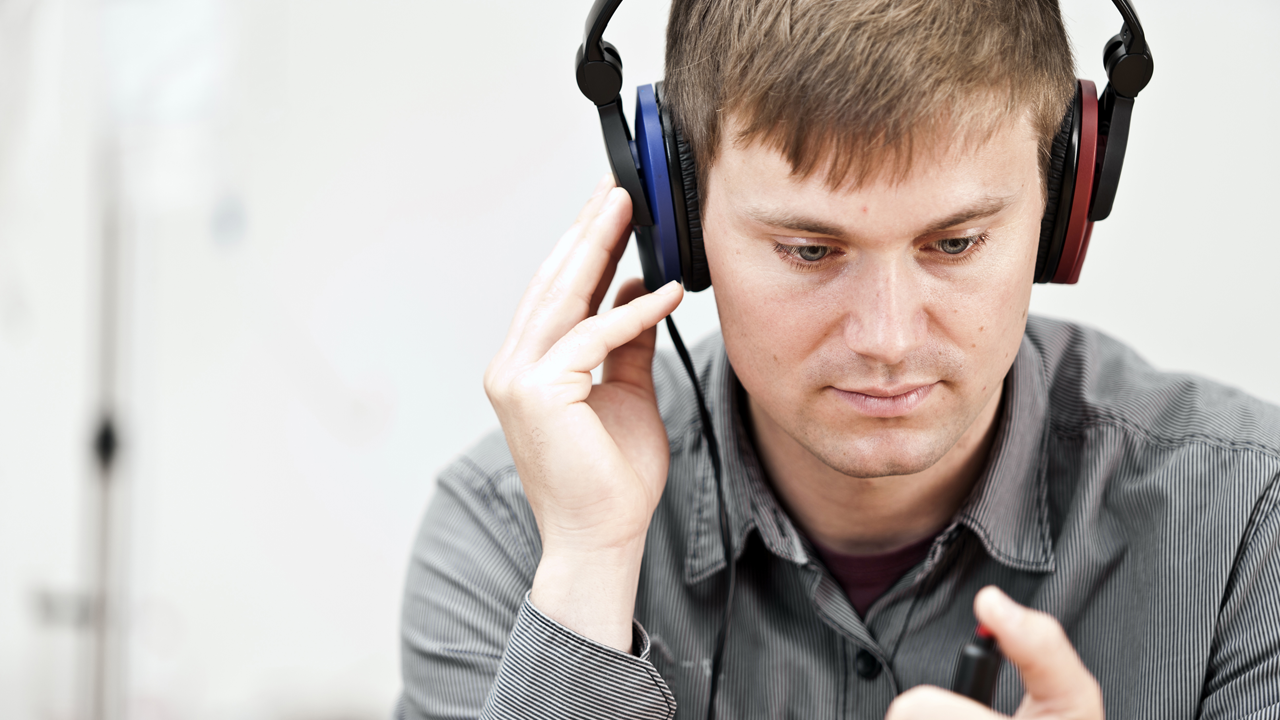 Man wearing headphones tests hearing