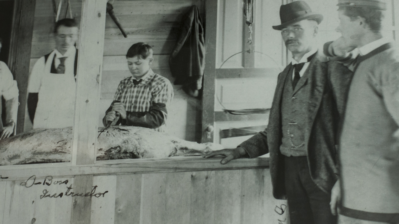 Historic photo of workers in U of M Meat Lab