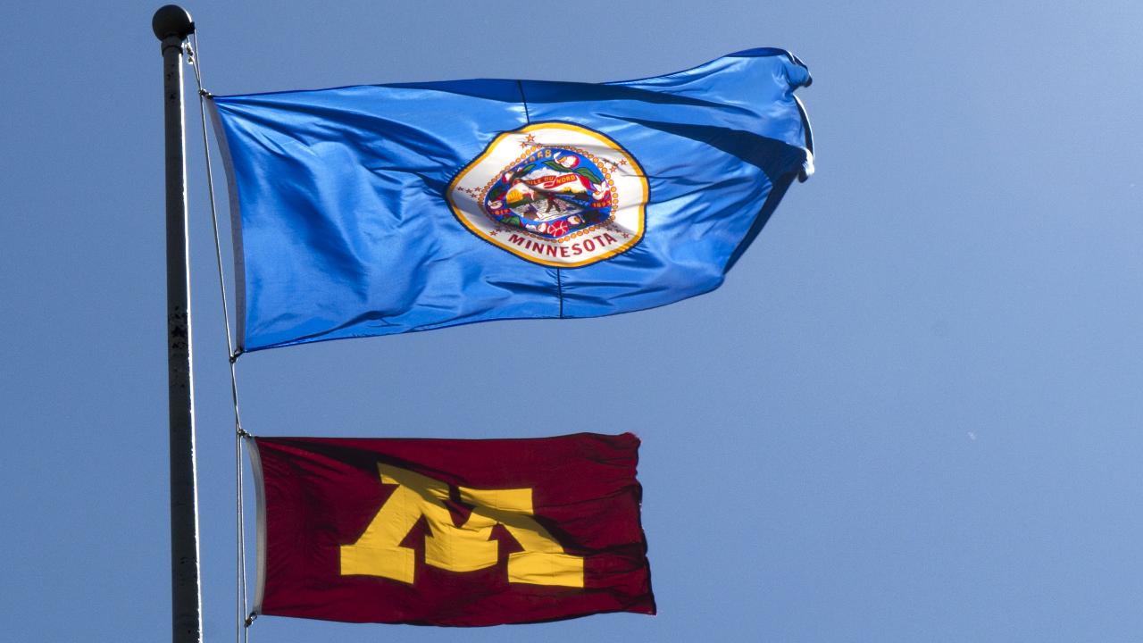 Minnesota state flag and University of Minnesota flag