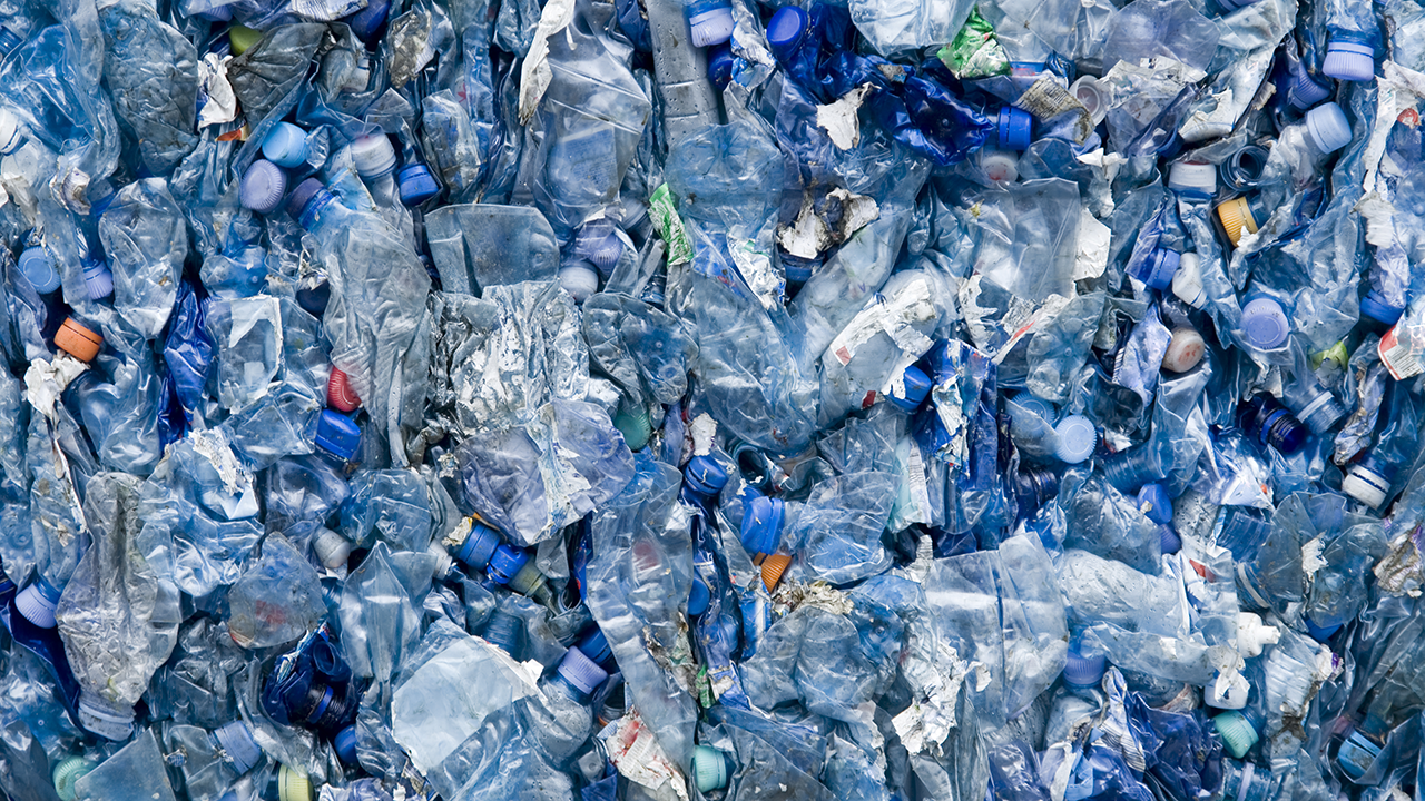 A large number of empty plastic bottles compressed together for recycling