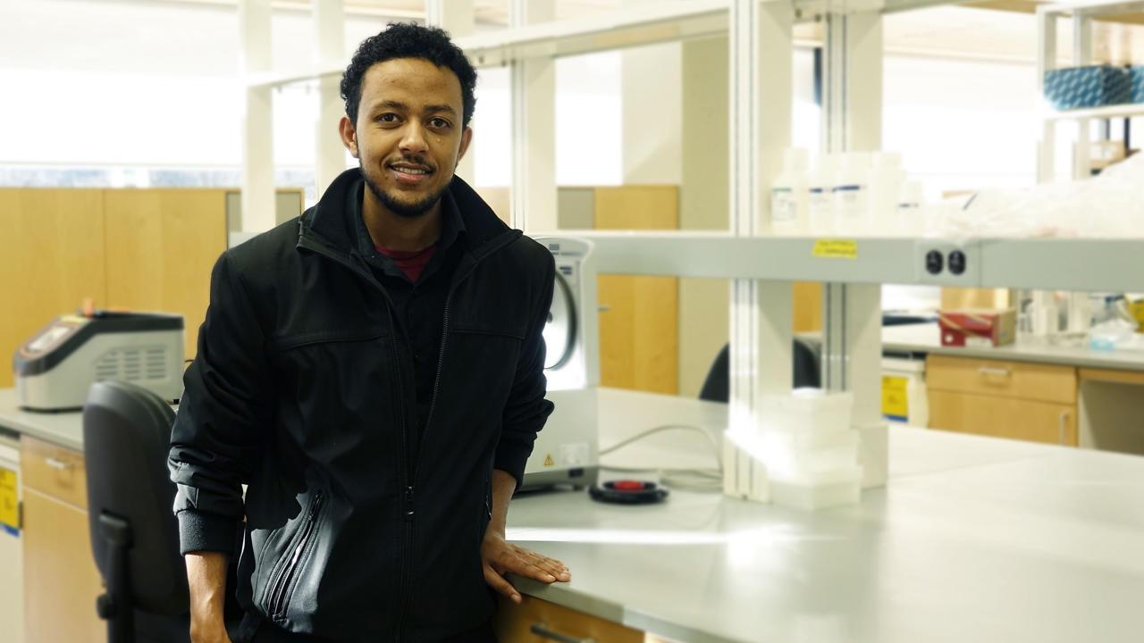 Student Tamirat Ali in a lab