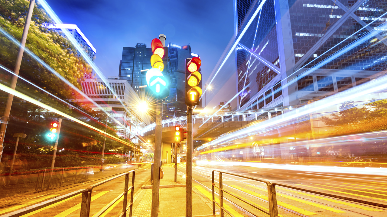 Long exposure photo of traffic lights amid busy city traffic