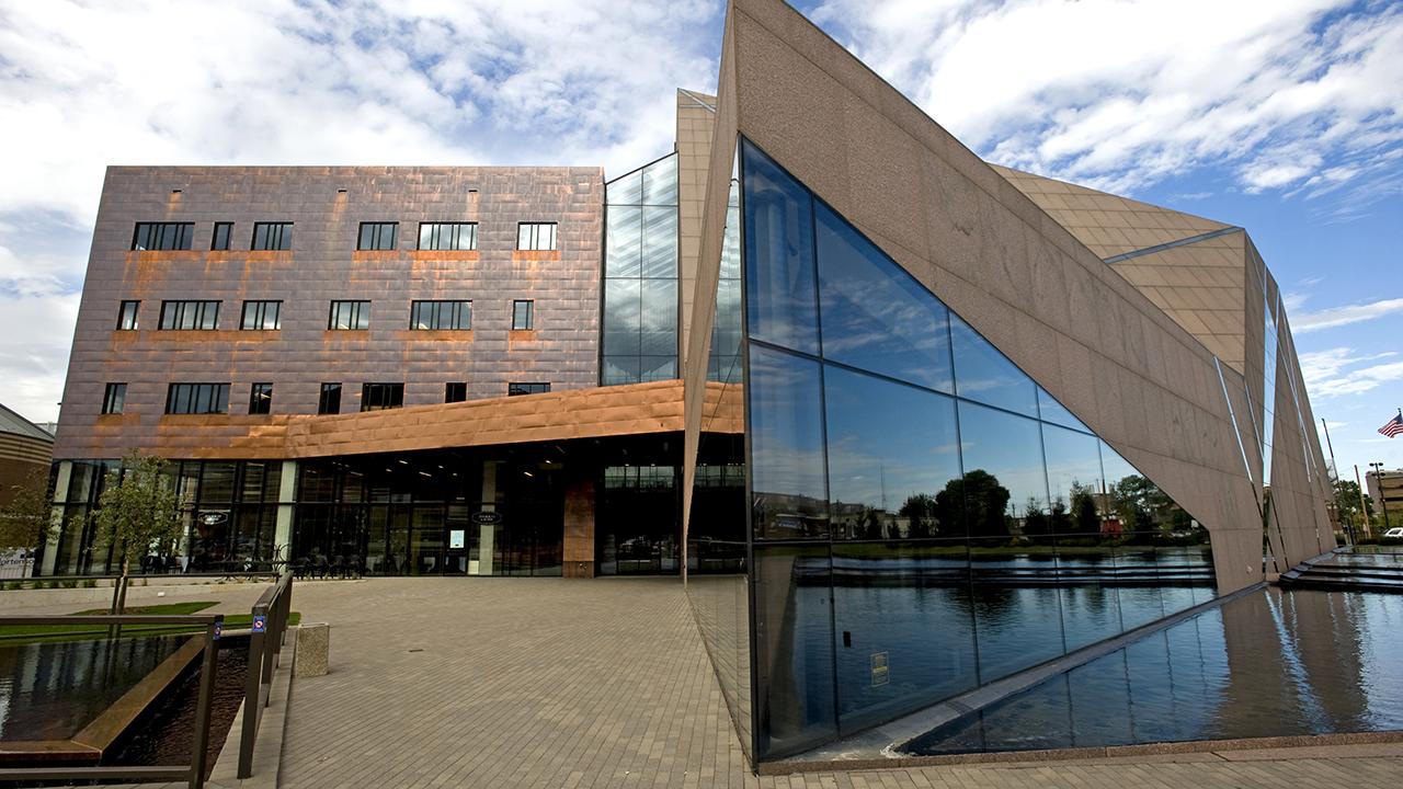 Exterior view of McNamara Alumni Center on a sunny day