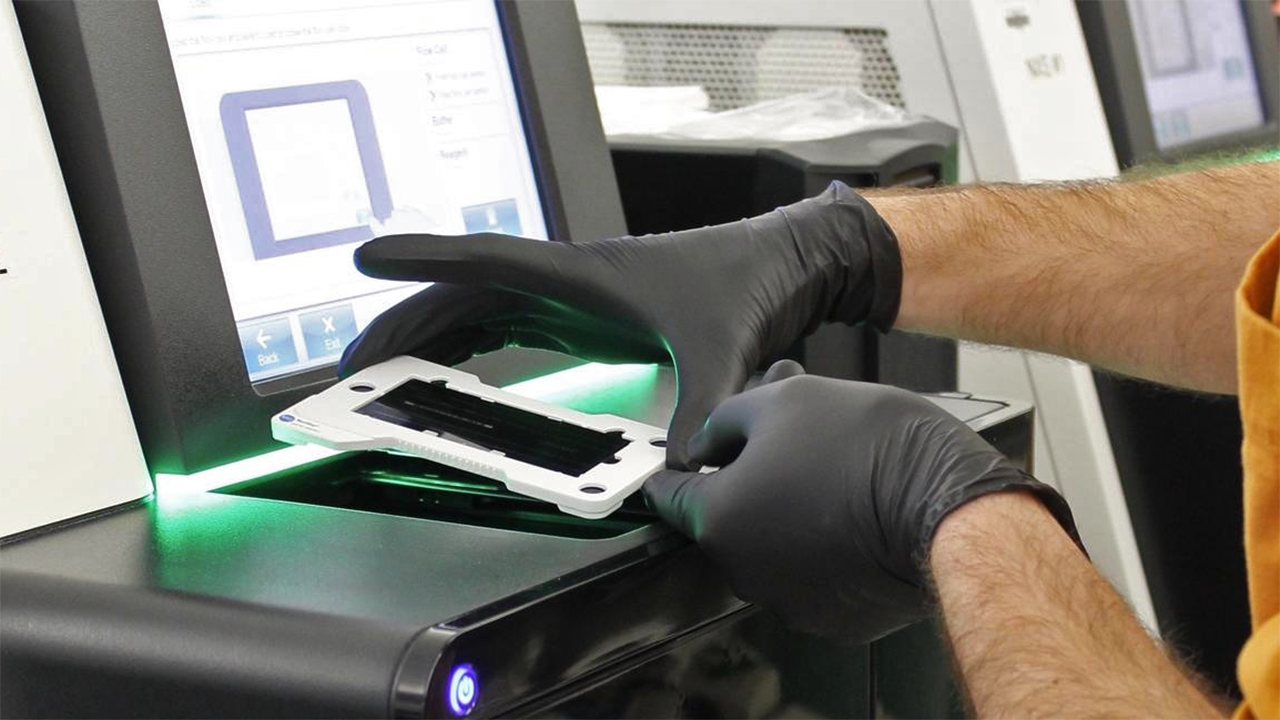 A sample being place into next-generation sequencing equipment in the UMGC lab