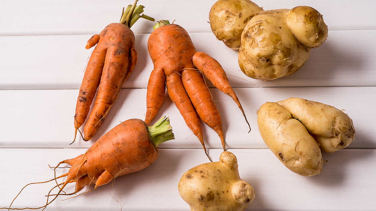Strangely shaped carrots and potatoes