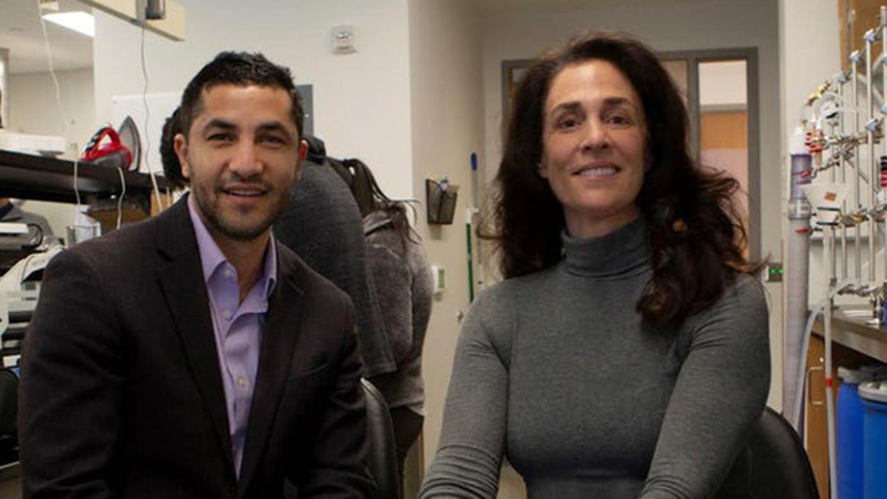 Abdennour Abbas and Michelle Bellanca sit in a laboratory