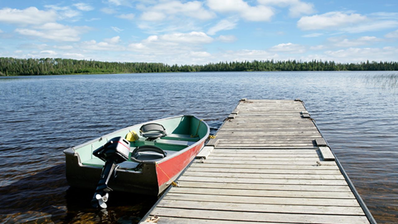 Boat tied to a dock on a lake