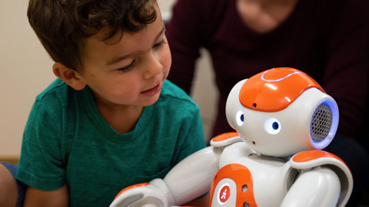 Autism-detecting robot interacts with a young child