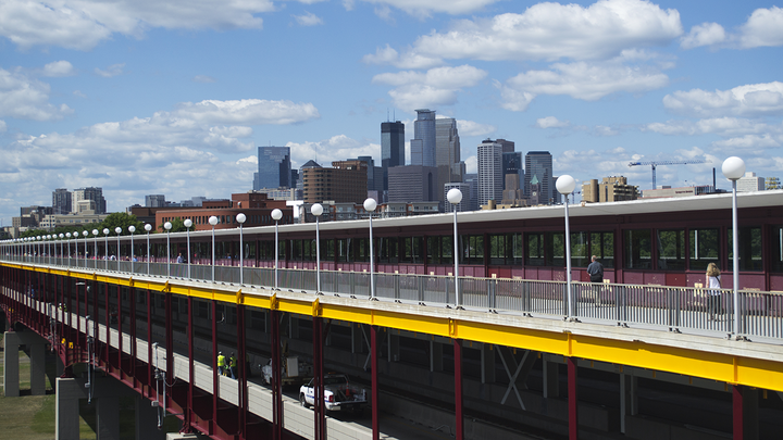 View of Washington Avenue Bridge in Minneapolis with downtown skyline in the background