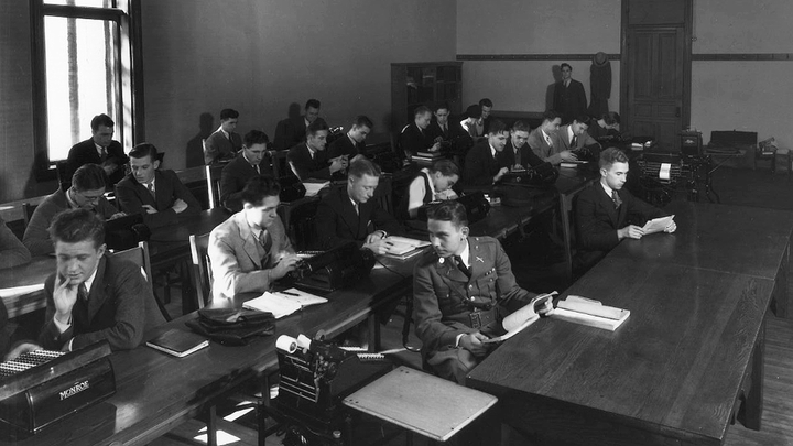 Students attend a business school class in the 1920s