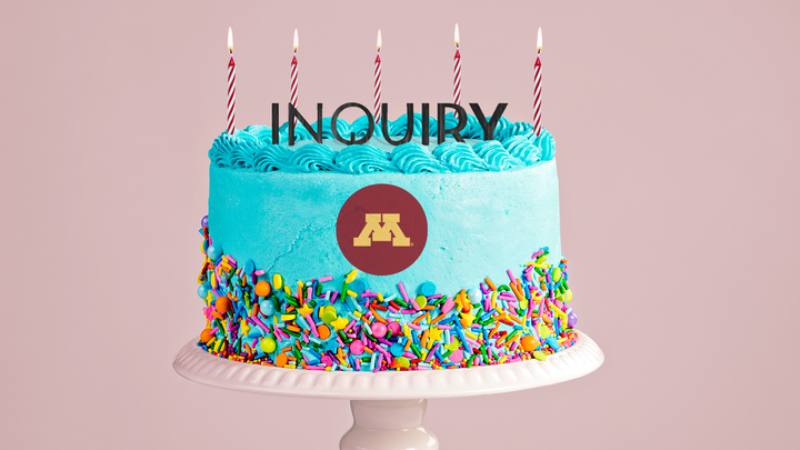 "Birthday cake with the word ""Inquiry"" atop"