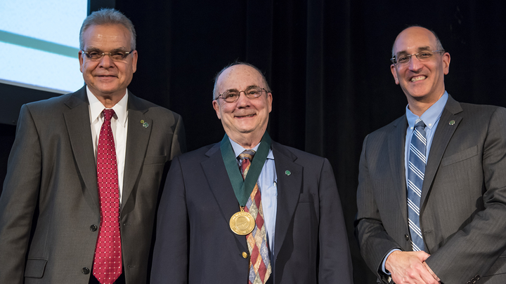 Robert Vince is honored onstage for his National Academy of Inventors Fellowship