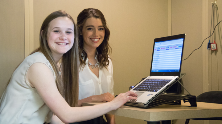 University of Minnesota Duluth students Jaclyn Friese and Claire Barnes use voice banking technology to record the voices of ALS patients for future use.