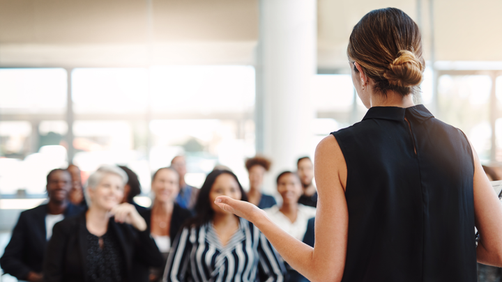 Woman pitching idea to an audience