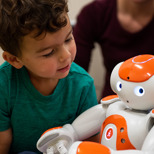 Child interacting with robot