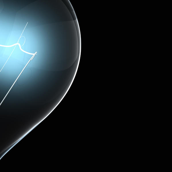 Blue light bulb over a black background