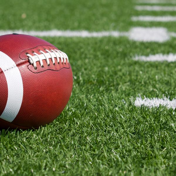 A football on a green field
