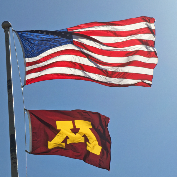 Flag pole with US flag and U of M flag