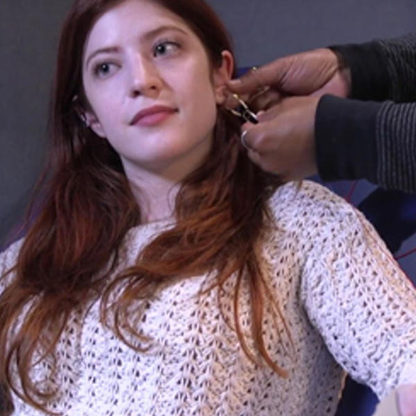 A woman being prepared for a hearing test