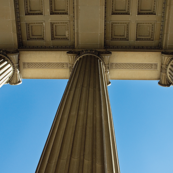 An upward view of the pillars in front of Northrop Auditorium