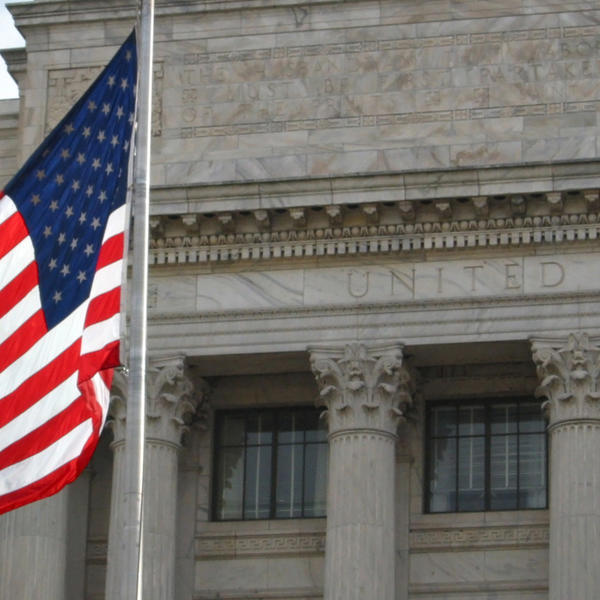 U.S. flag in front of a building