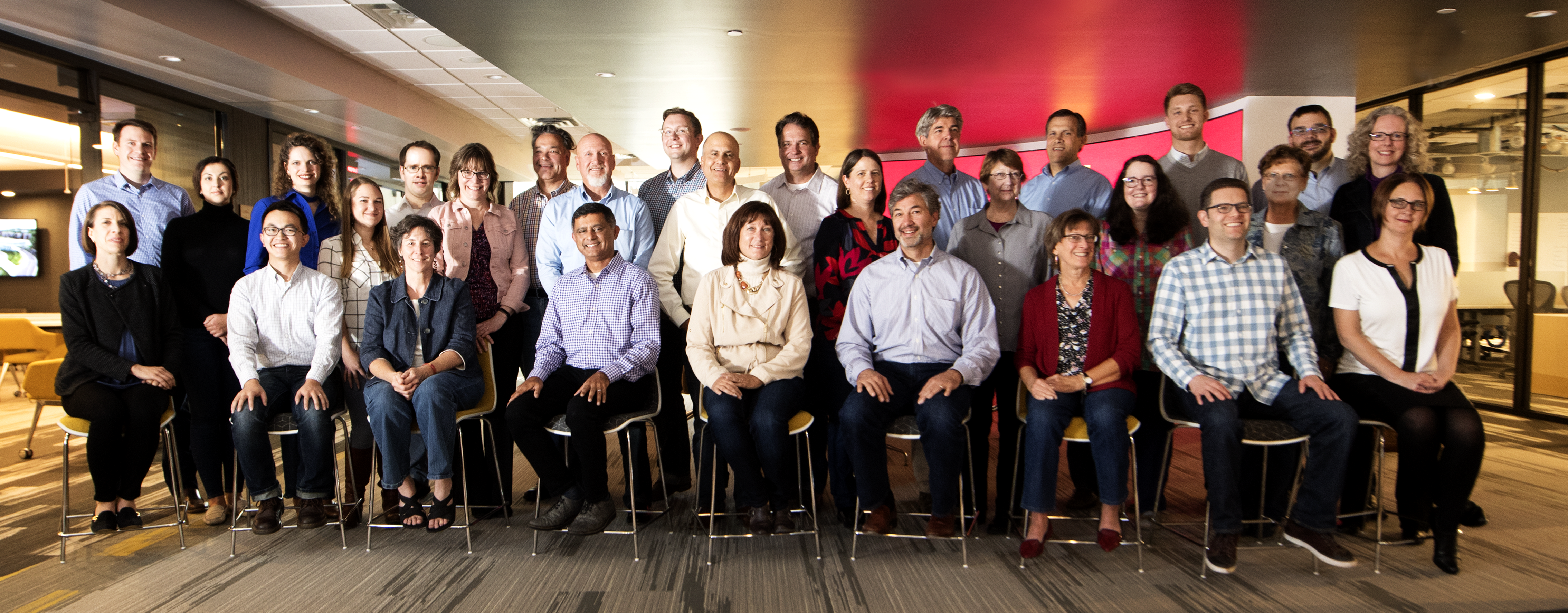 29 staff members of Technology Commercialization standing/sitting together for photo