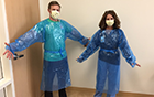 Nick Houkom, RN, Nurse Manager Pediatric CVICU & Teresa Cahill, RN, Nurse Manager Pediatric Emergency Department at M Health University of Minnesota Masonic Children's Hospital model the Gown for U